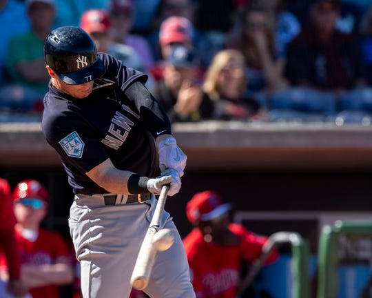 New York Yankees outfielder Clint Frazier (77) hits a sacrifice fly scoring infielder Miguel Andujar (not pictured) during the sixth inning against the Philadelphia Phillies at Spectrum Field on Mar 7, 2019 in Clearwater, Fla.