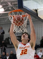 Zachary Freemantle dunks during second half action. Bergen Catholic Boys Basketball defeats Camden Catholic in Non-Public A Final in Toms River, NJ on March 9, 2019.
