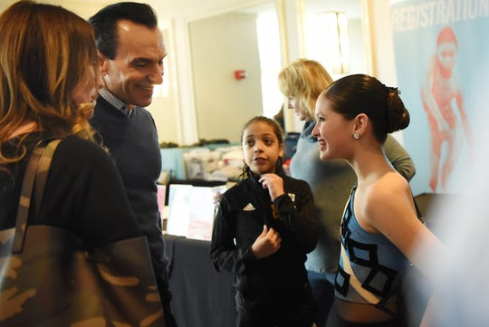 New York City Dance Alliance held a regional dance competition at the Hilton Meadowlands in East Rutherford on Friday March 8, 2019. Joe Lanteri - Executive Director, Regional, National, and Summer Intensive Faculty of NYCDA talks to Gillian Gordon, 12 after her solo performance.