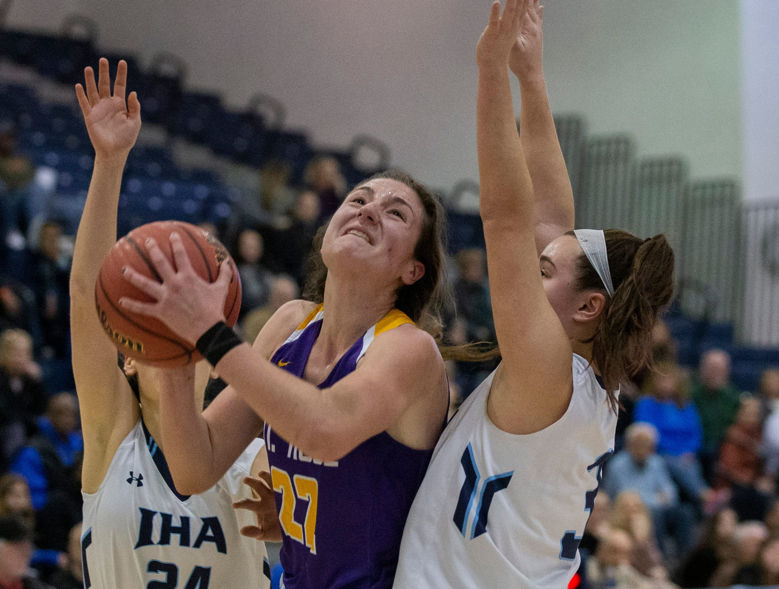 St Rose's Brynn Farrell (22) gets blocked in by IHA's Lexi Edmonds and Brittany Graff during first-half action. St. Rose girls basketball vs. Immaculate Heart Academy in Non-Public A Final in Toms River, N.J. on March 9, 2019.