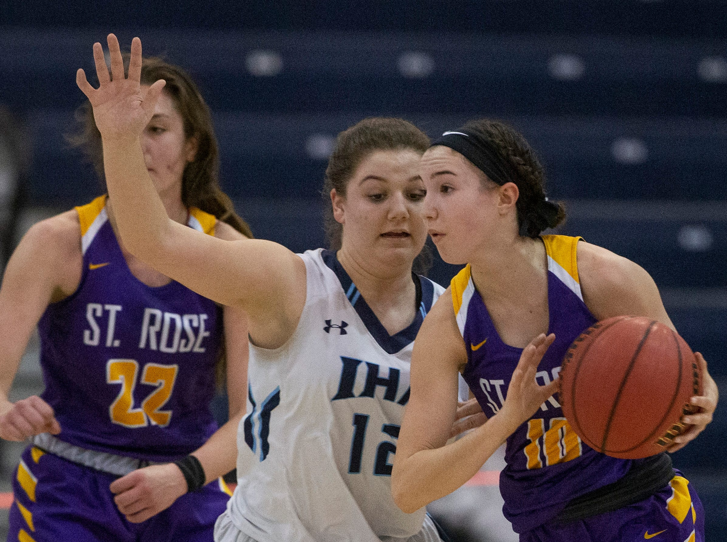 IHA's Samanatha Rinaldi works to cover St. Rose's Abigail Antognoli during first half action. St. Rose Girls Basketball vs Immaculate Heart Academy in Non-Public A Final in Toms River, NJ on March 9, 2019.