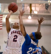 Saniah Caldwell (2) of Saddle River Day goes up with shot as she covered by Leianya Massenat of Trenton Catholic during first-half action. Saddle River Day girls basketball vs Trenton Catholic in Non-Public B Final in Toms River, N.J. on March 9, 2019.