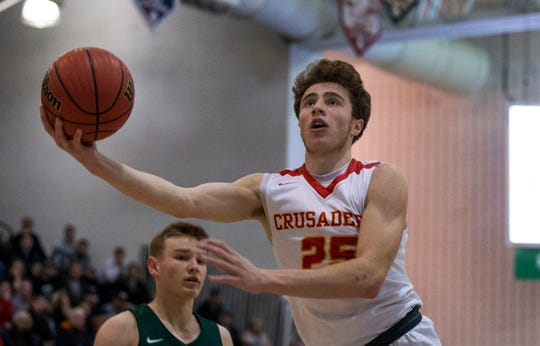 Doug Edert goes up with shot during second half action. Bergen Catholic Boys Basketball defeats Camden Catholic in Non-Public A Final in Toms River, NJ on March 9, 2019.