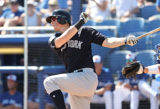New York Yankees infielder DJ LeMahieu (26) hits a RBI single during the third inning against the Toronto Blue Jays at Dunedin Stadium.  TODAY Sports