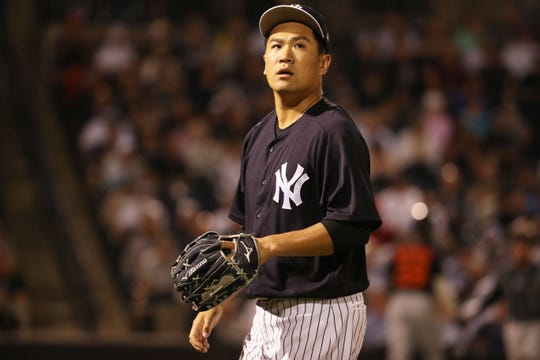 Mar 8, 2019; Tampa, FL, USA;New York Yankees starting pitcher Masahiro Tanaka (19) looks on at the end of the third inning against the Detroit Tigers at George M. Steinbrenner Field.
