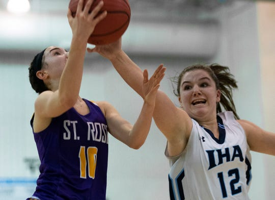 IHA guard Samanatha Rinaldi (12) tries to block a layup by St. Rose's Abigail Antognoli during second-half action. St. Rose girls basketball vs Immaculate Heart Academy in Non-Public A Final in Toms River, N.J. on March 9, 2019.
