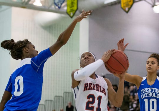 Sydnei Caldwell, Saddle River drive to basket against Naomi Shorts, Trenton Catholic. Saddle River Girls Basketball vs Trenton Catholic in Non-Public B Final in Toms River, NJ on March 9, 2019.