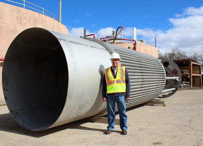 Las Cruces Utilities Wastewater Plant Manager Lorenzo Martinez is dwarfed by a new component being installed at the Jacob Hands Wastewater Treatment Facility on the city's west side. The installation of the new heating water jacket will be a huge undertaking by LCU staff and contractors to make sure that  sewage treatment continues to run smoothly.
