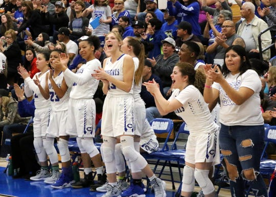 The Carlsbad bench applauds Tori Flores after she made a contested shot late in the fourth quarter of Friday's game against Centennial.