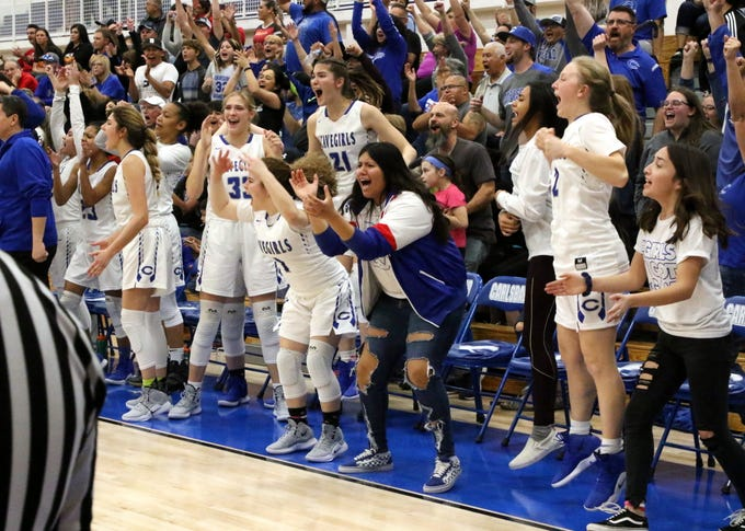 Carlsbad's bench erupts after Carsyn Boswell drained a 3-pointer to give her team the lead late in the fourth quarter of Friday's game against Centennial.