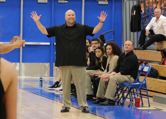 Centennial coach Louie Laborin doesn't agree with a call during Friday's game against Carlsbad.