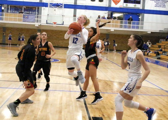 Carlsbad's Carsyn Boswell is fouled while attempting a layup in the first quarter of Friday's game against Centennial.
