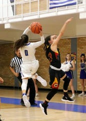 Baylee Molina gets off a contested fastbreak layup in the fourth quarter of Friday's game against Centennial.
