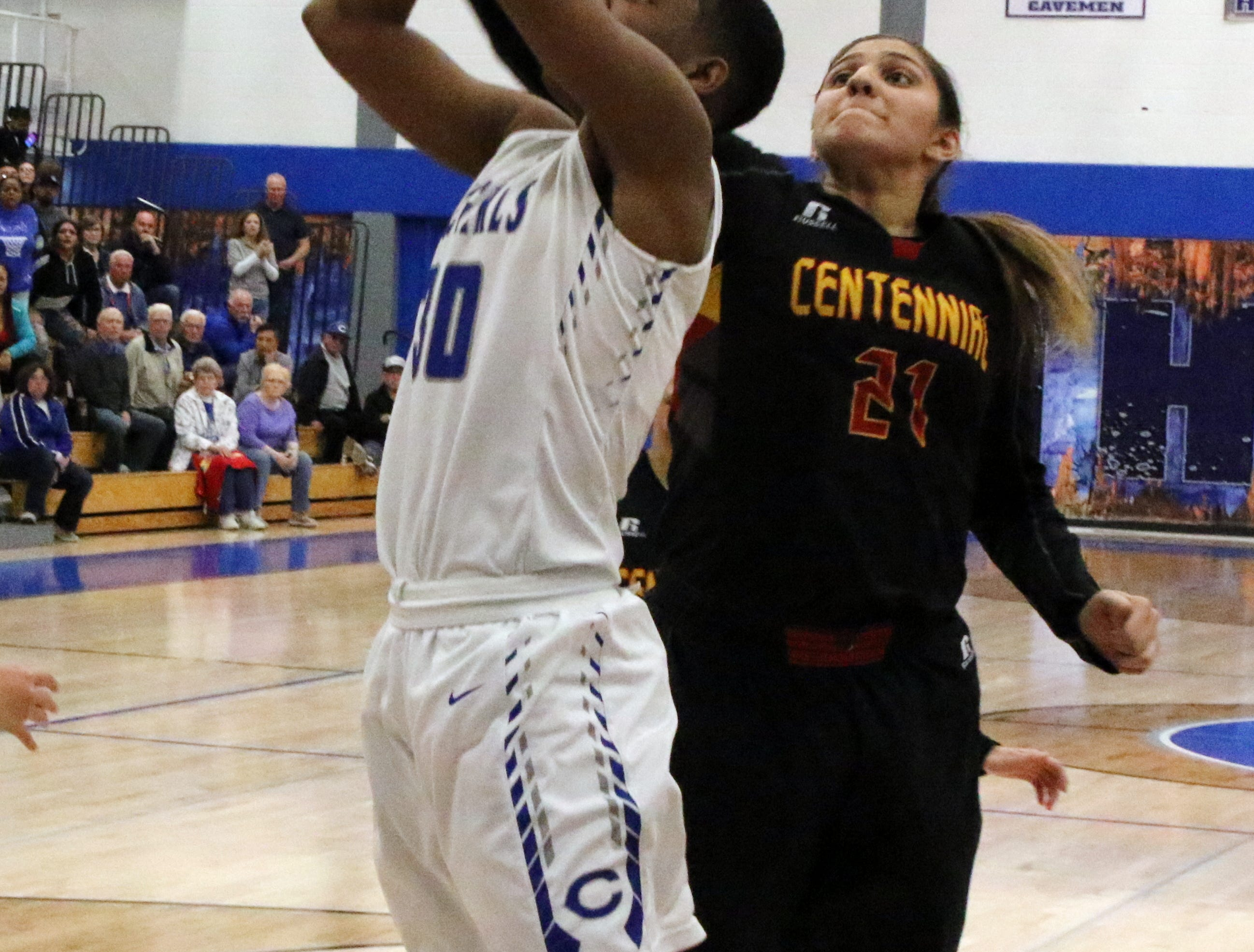Carlsbad's Dayshaun Moore's shot is blocked by Centennial's Dianne Hefner in the fourth quarter of Friday's game.