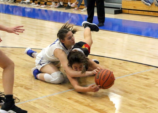 Carlsbad's Morgan Boatwright, left, and Centennial's Larissa Laborin, right, fight for a loose ball in the first half of Friday's game.