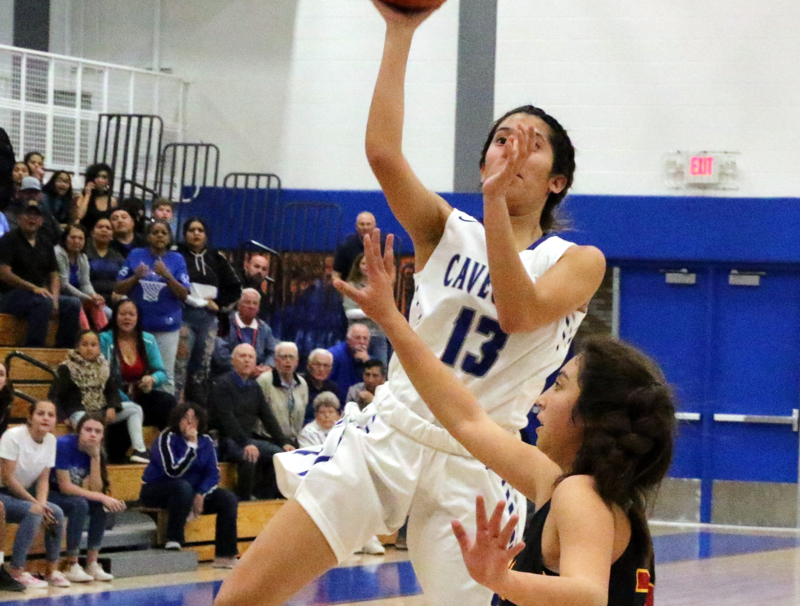 Tori Flores takes a contested shot against Centennial.