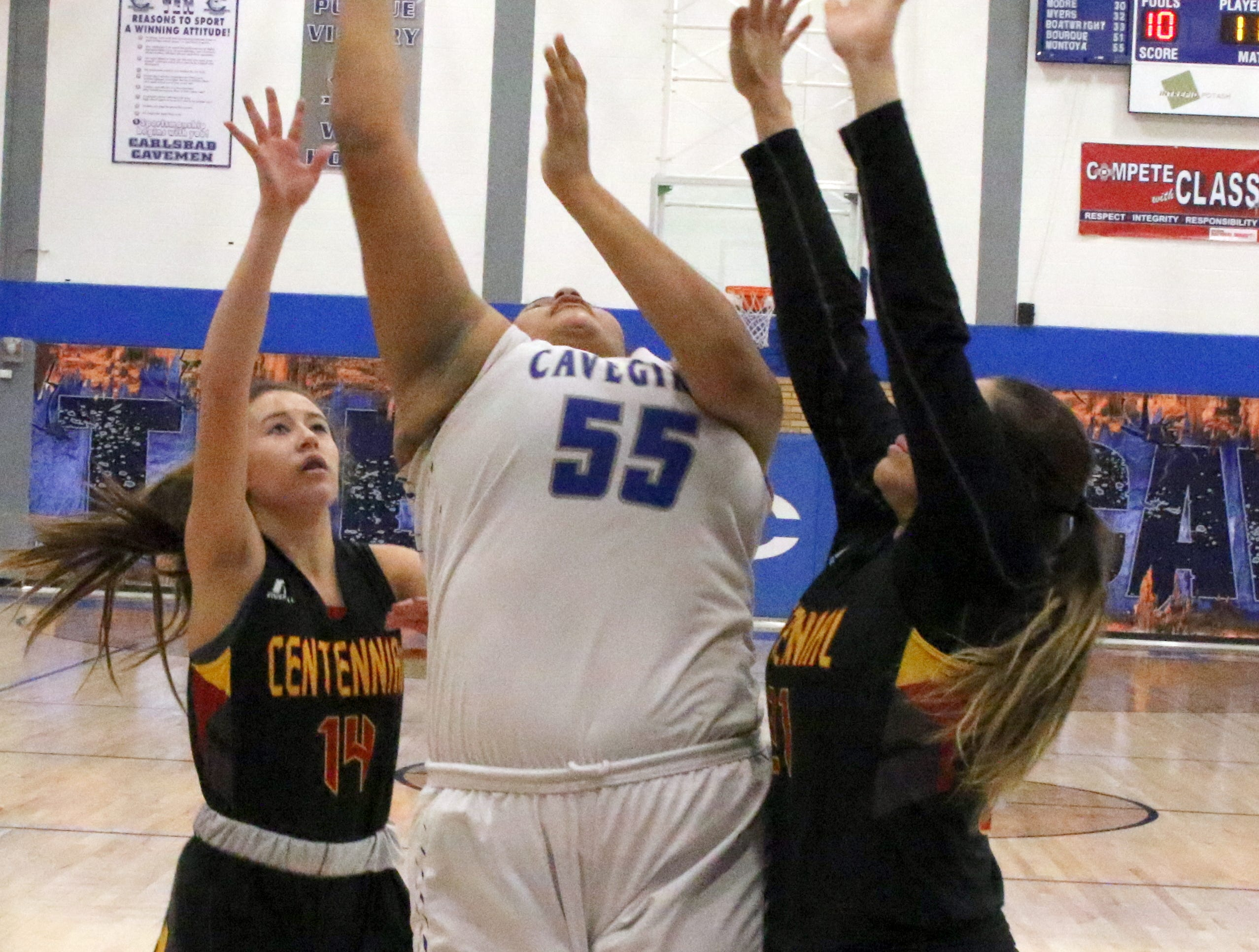 Kaliyah Montoya takes a contested shot in the fourth quarter of Friday's game against Centennial.