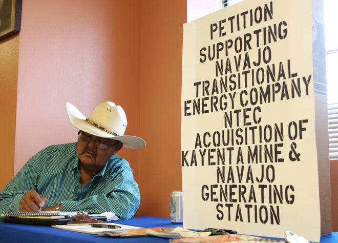 Carl Holiday collects signatures on Friday for a petition to support the Navajo Transitional Energy Company's proposal to takeover the Navajo Generating Station and Kayenta Mine.