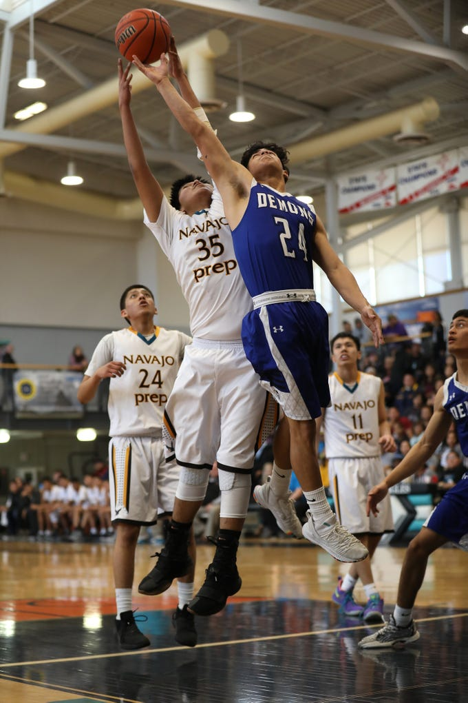 Navajo Prep's Ian Whitehorse and Dexter's Isaac Irigoyen battle for a rebound in Saturday's 3A playoff opener at the Eagles Nest in Farmington.