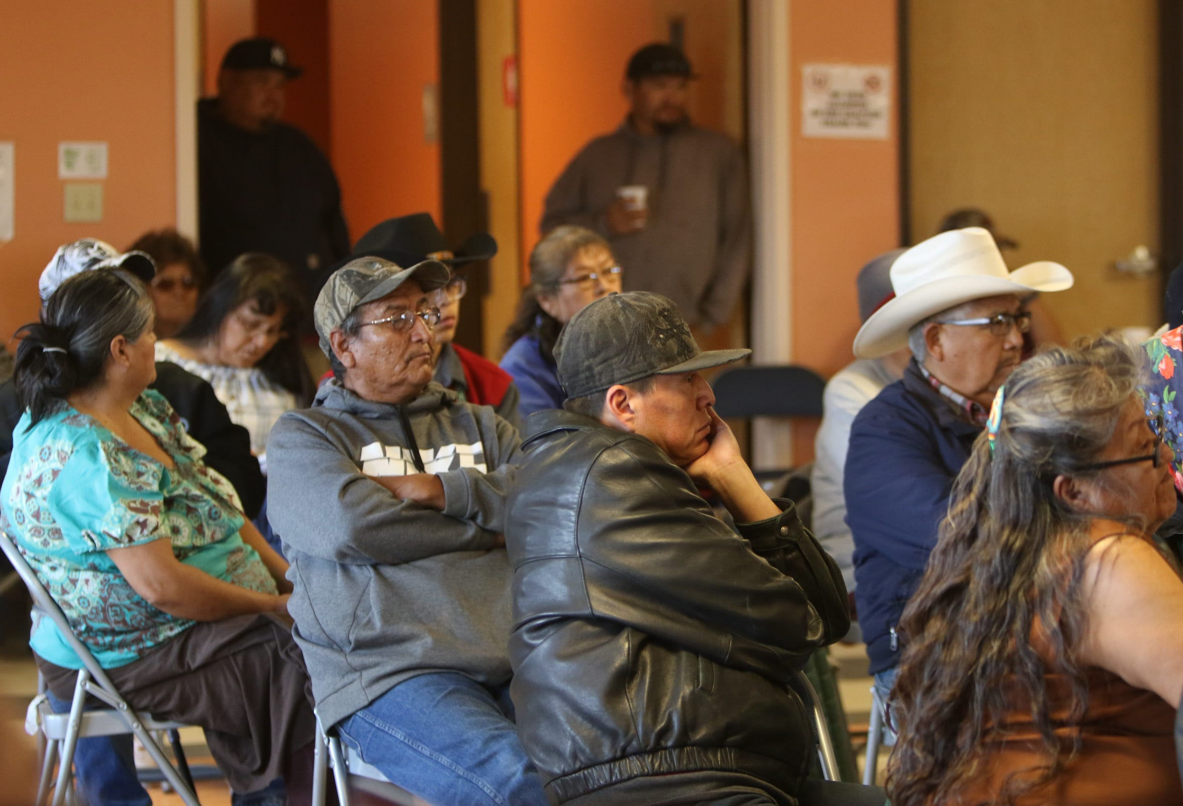 Community members listen to comments on Friday during the town hall meeting at the Hardrock Chapter house in Hardrock, Ariz.
