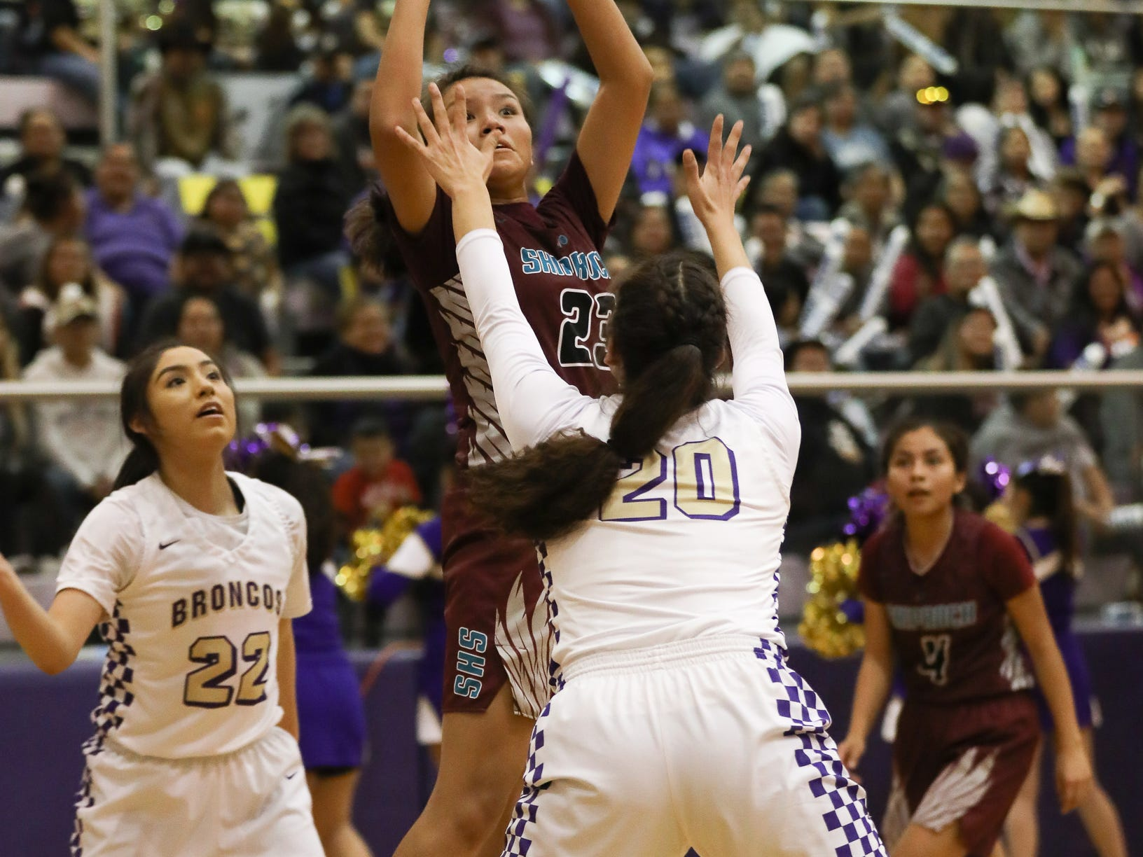 Shiprock's Aaryanna Lansing shoots a jumper over Kirtland Central's Siigrid Lii'binaghahi during Friday's 4A playoff opener at Bronco Arena in Kirtland.