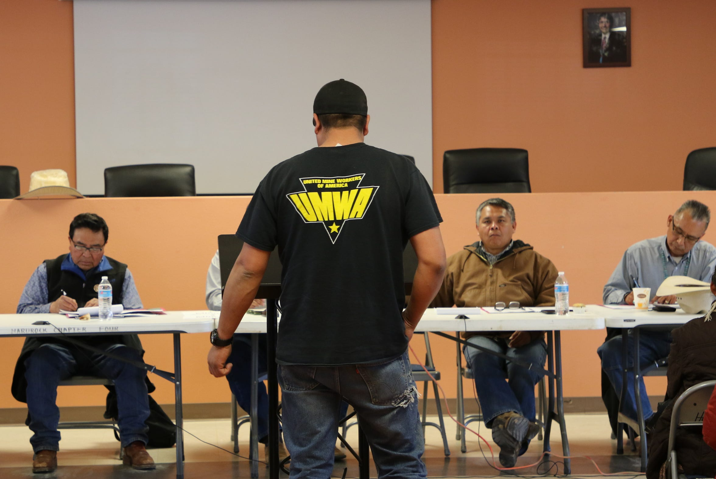 Kayenta Mine employee Nathan Gray, center, provides comments that favor continuing the coal mining operation on Black Mesa at the town hall meeting on Friday at the Hardrock Chapter house in Hardrock, Ariz.
