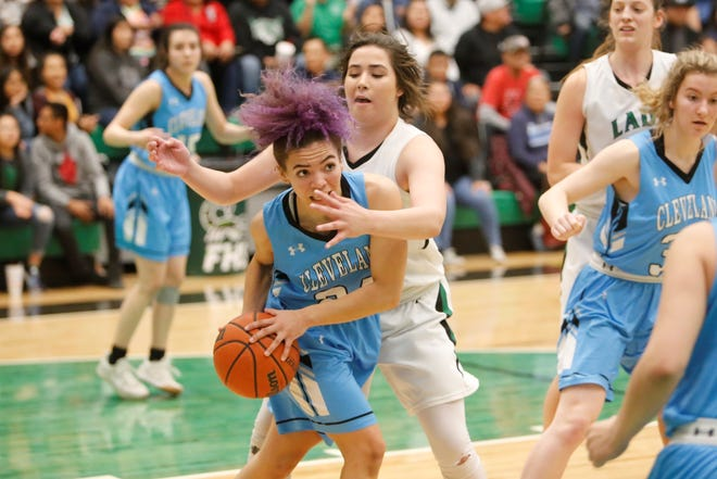 Farmington's Chloe Finch looks to get a defensive stop against Cleveland's Kaylee Caldwell during Friday's 5A playoff opener at Scorpion Arena in Farmington. Visit daily-times.com to see the latest sports photo galleries and video highlights.