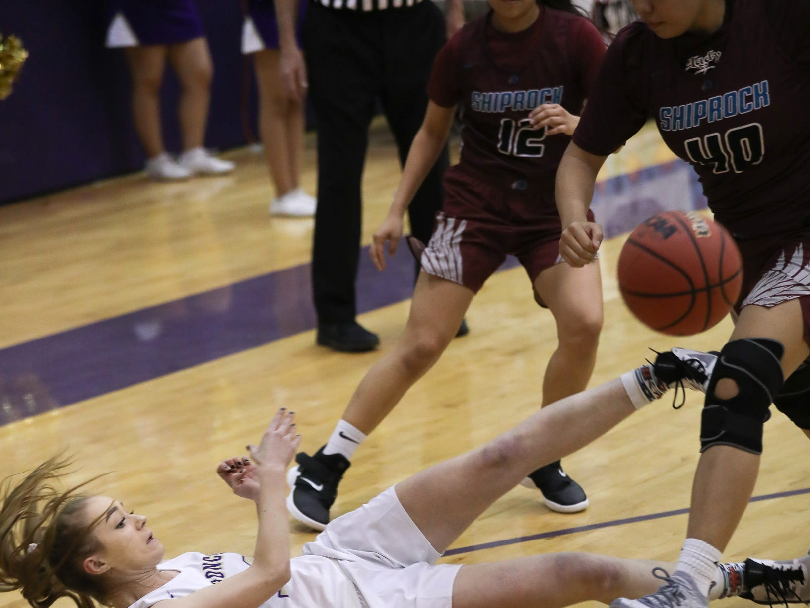 Kirtland Central's Jayden Guillory steals the ball from Shiprock's Kimora Tso (12) and Marielynn Lansing (40) during Friday's 4A playoff opener at Bronco Arena in Kirtland.