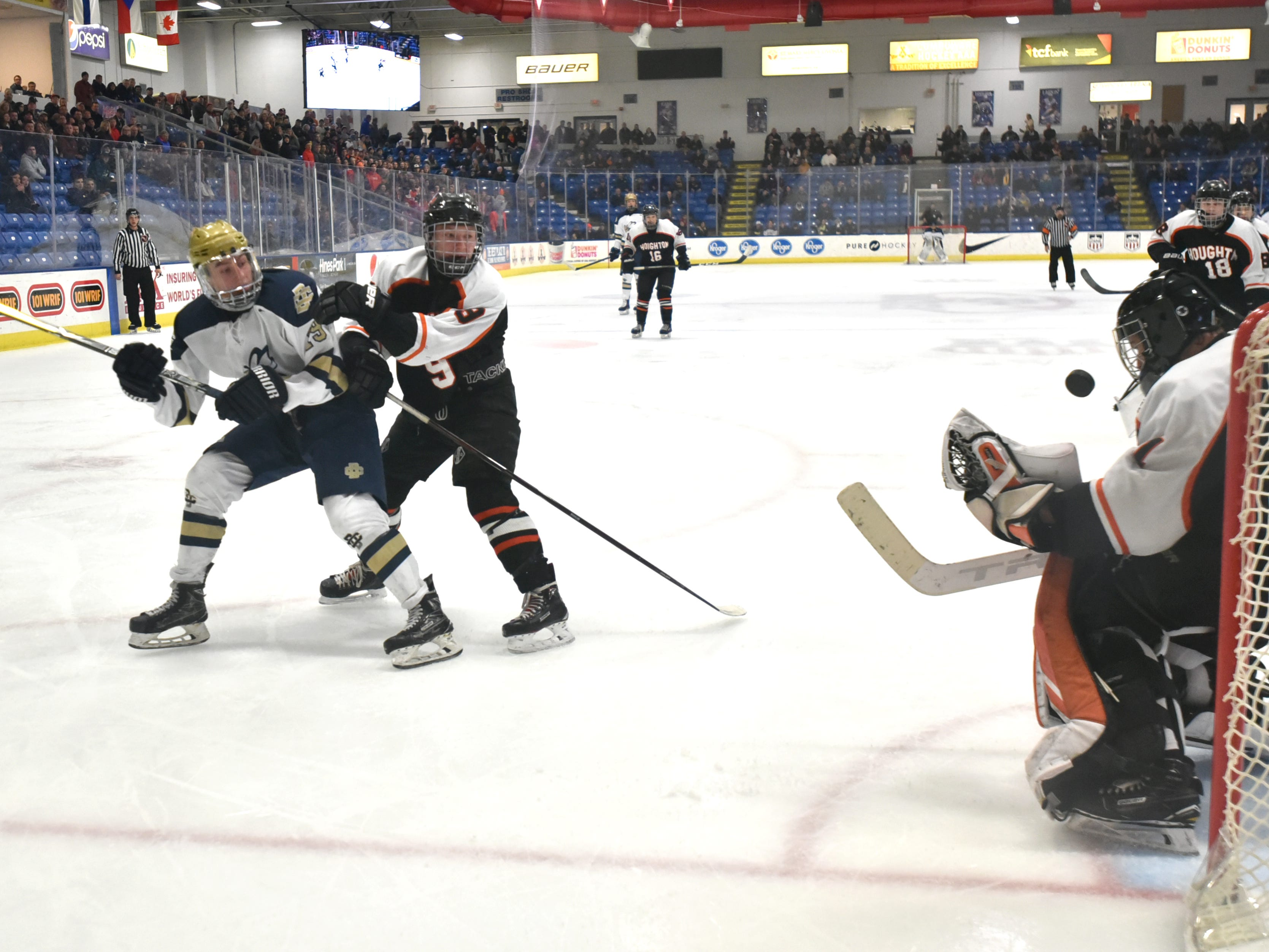Country Day's Logan Gotinsky, left, sends a shot that's saved by Houghton goalie Jimmy Pietila during the first period.