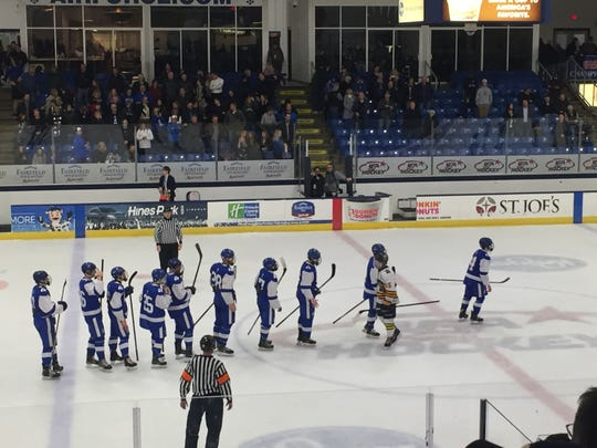 Catholic Central shakes hand with Rochester after advancing to the state final at USA Hockey Arena in Plymouth, MI.