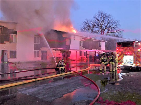 A fast-spreading fire raged through the Canton Crossings apartment complex Friday night.