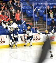 Just after killing off a long 5-on-3 power play Detroit Country Day celebrates their third goal against Houghton.