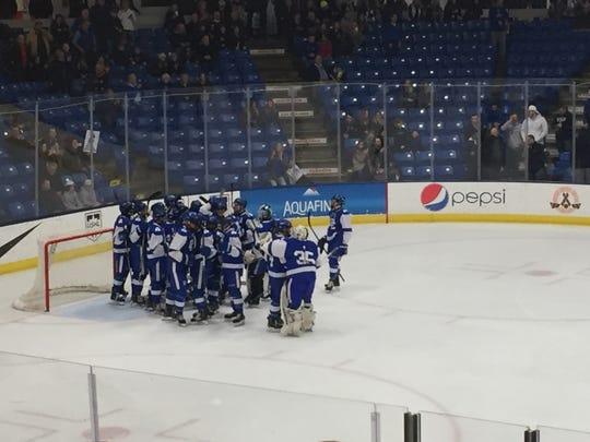 Catholic Central celebrates advancing to the state final after beating Rochester on March 8 in Plymouth, MI.