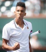 Canadian Felix Auger-Aliassime celebrates his match against Stefanos Tsitsipas, of Greece on Stadium One at the 2019 BNP Paribas Open at Indian Wells Tennis Garden on March 9, 2019. Auger-Aliassime won their second round match in two sets 6-4, 6-2.
