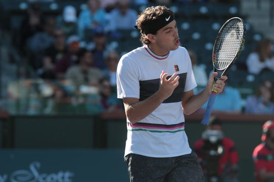Taylor Fritz reacts to a point in the second set of his match against Steve Johnson at the BNP Paribas Open, Indian Wells, Calif., March 8, 2019.