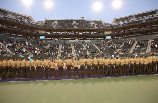 "Marines and Color Guard from 29 Palms unfurl the flag during the ""Salute to Heroes"" at the BNP Paribas Open, March 8, 2019."