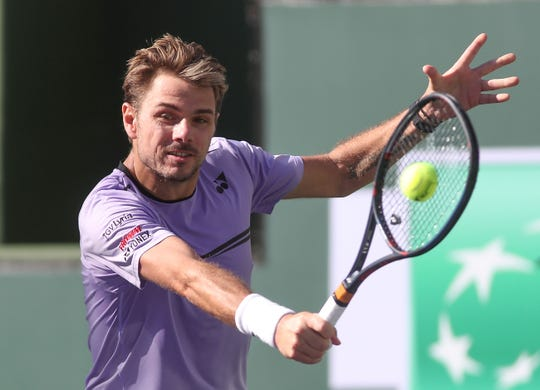 Stan Wawrinka hits a shot during his match against Daniel Evans at the BNP Paribas Open, March 8, 2019.