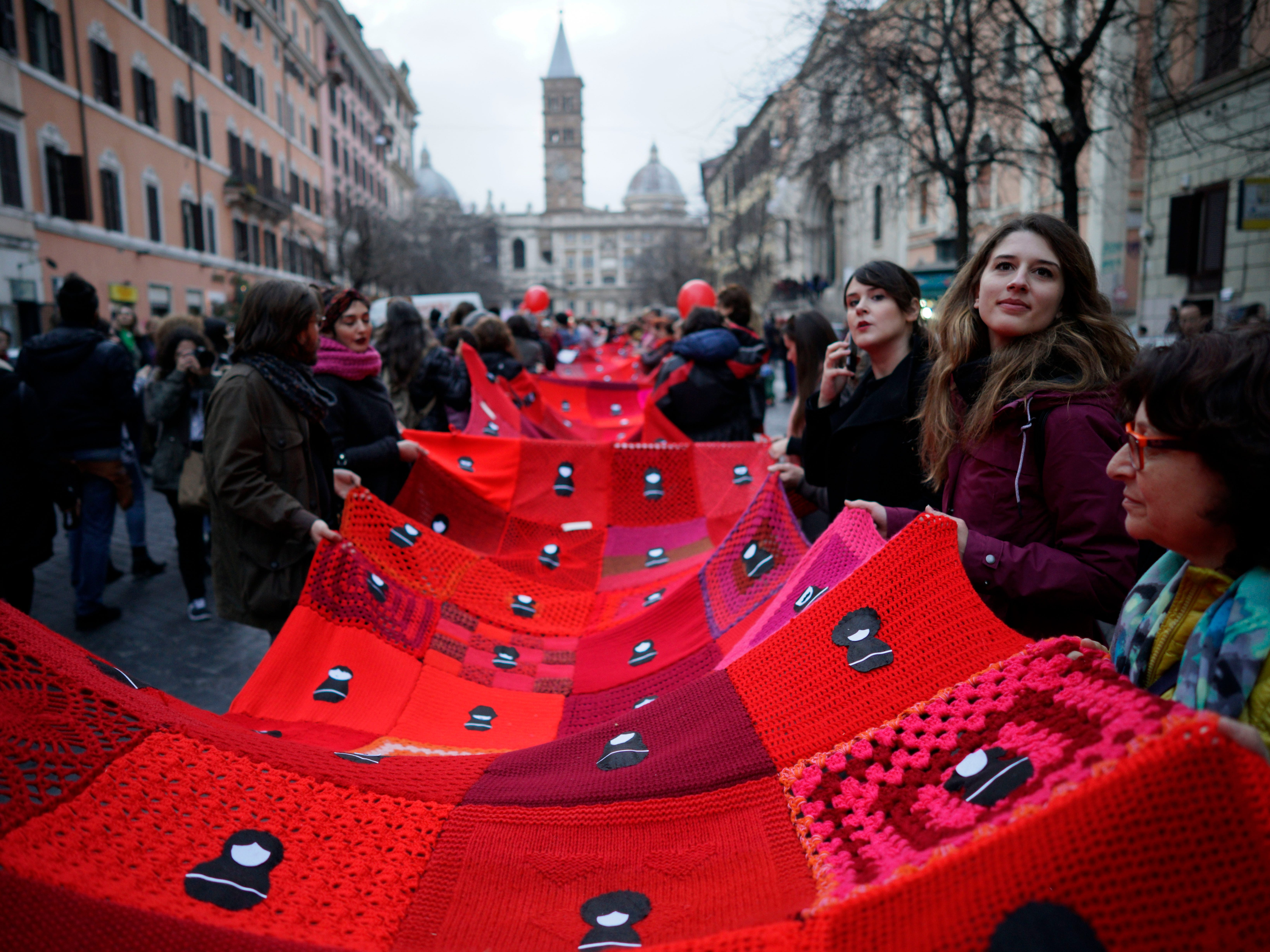 People take part in a demonstration to mark the International Women's Day, in Rome, Friday, March 8, 2019. The day, sponsored by the United Nations since 1975, celebrates women's achievements and aims to further their rights. (AP Photo/Andrew Medichini)