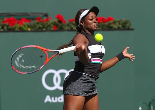 Sloane Stephens hits a shot during her loss to Stephanie Voegele at the BNP Paribas Open, March 8, 2019.