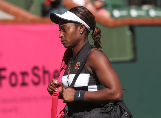 Sloane Stephens walks off the court after her loss to Stephanie Voegele at the BNP Paribas Open, March 8, 2019.