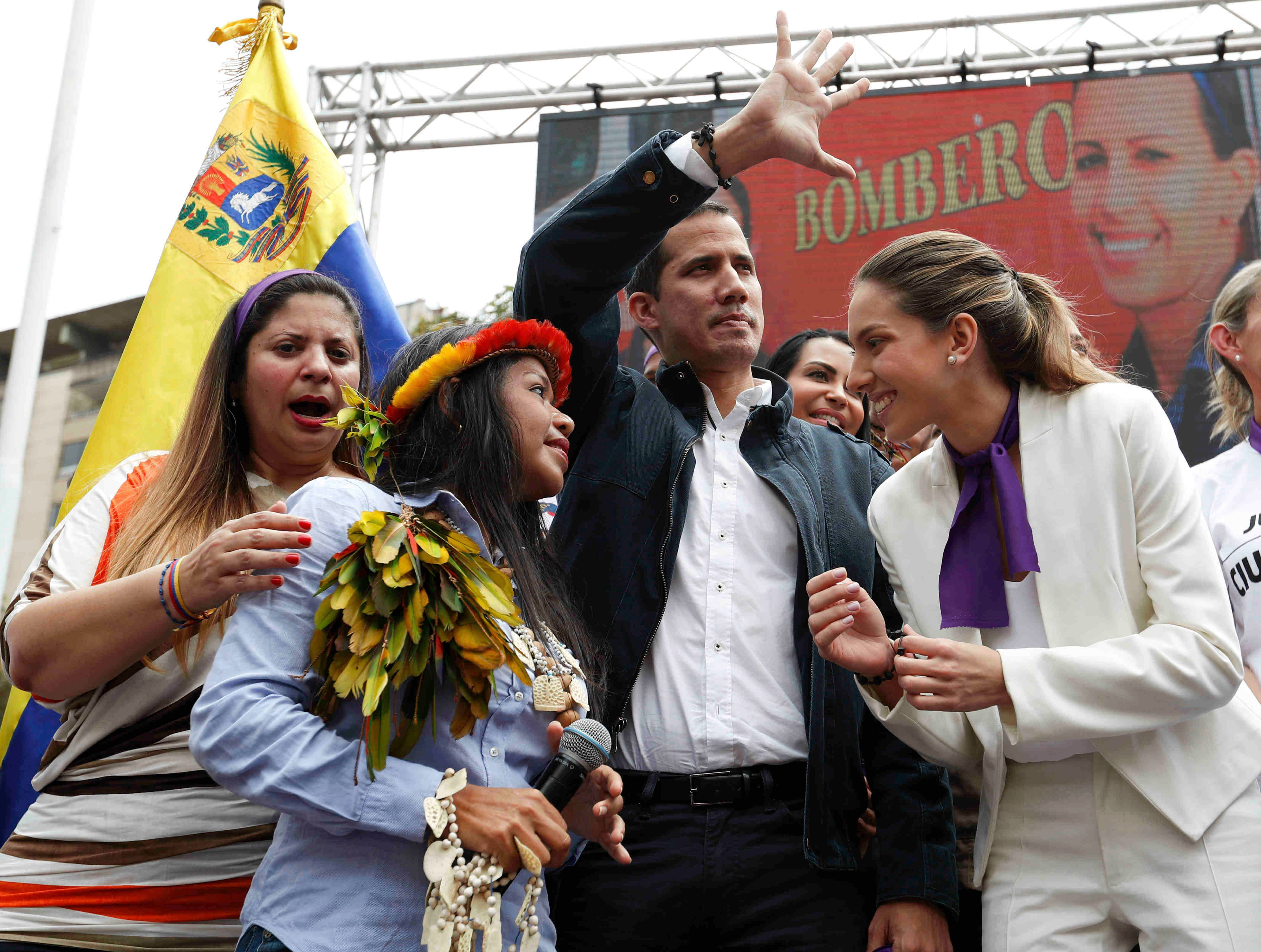 Accompanied by his wife Fabiana Rosales, right, Venezuelan opposition leader Juan Guaido, who has declared himself interim president, greets supporters as he arrives for a rally to commemorate International Women's Day in Caracas, Venezuela, Friday, March 8, 2019. (AP Photo/Eduardo Verdugo)