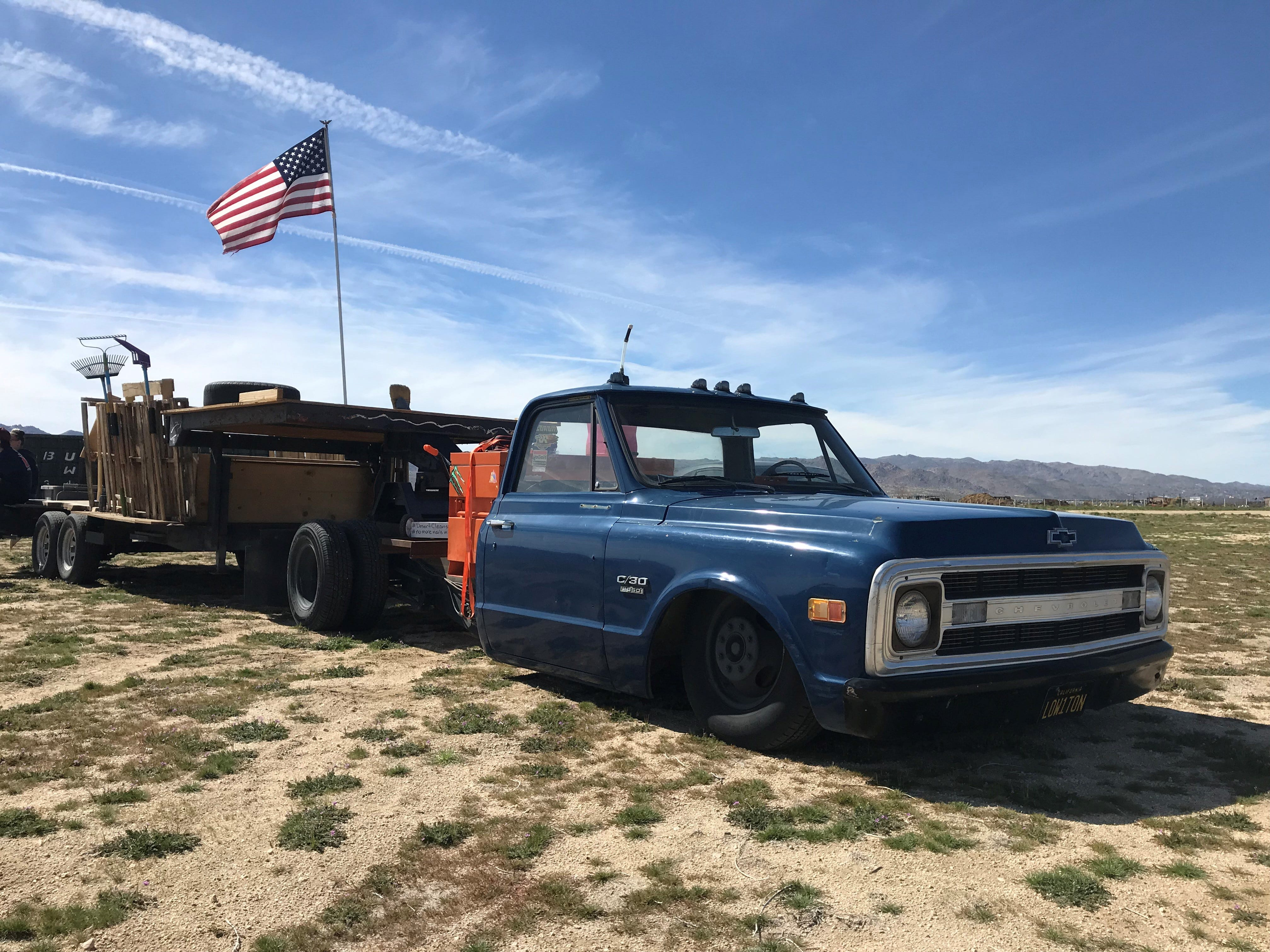 Joshua Tree residents Colin and Jillian Sauter use a 1970 low-rider pickup truck to haul trash they've picked up in the high desert.