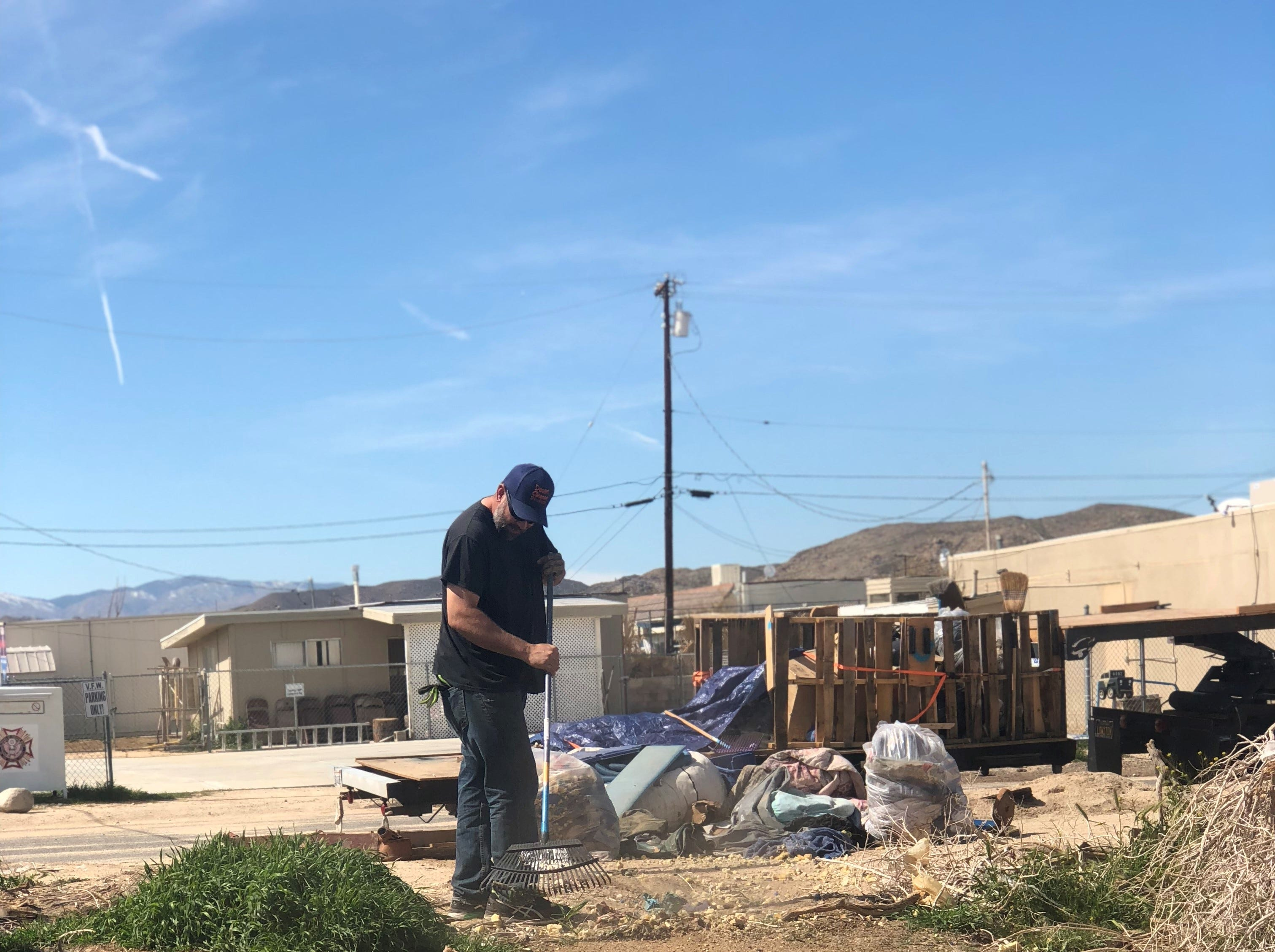 Colin Sauter, left, has been cleaning up the desert with his wife, Jillian Sauter, for more than a decade.