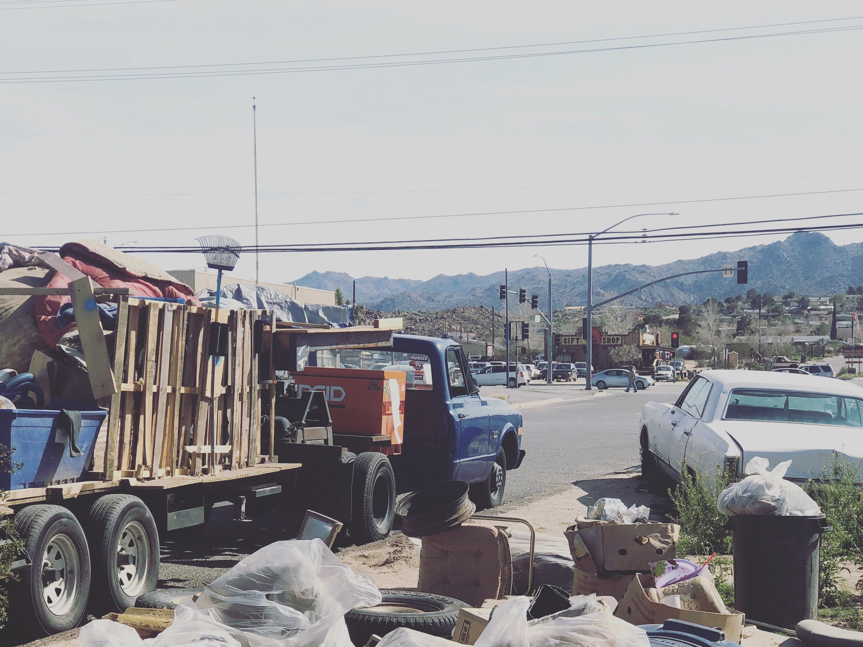 The couple use their low-rider truck and trailer to pick up trash bags and discarded materials throughout Joshua Tree, Landers and Johnson Valley.