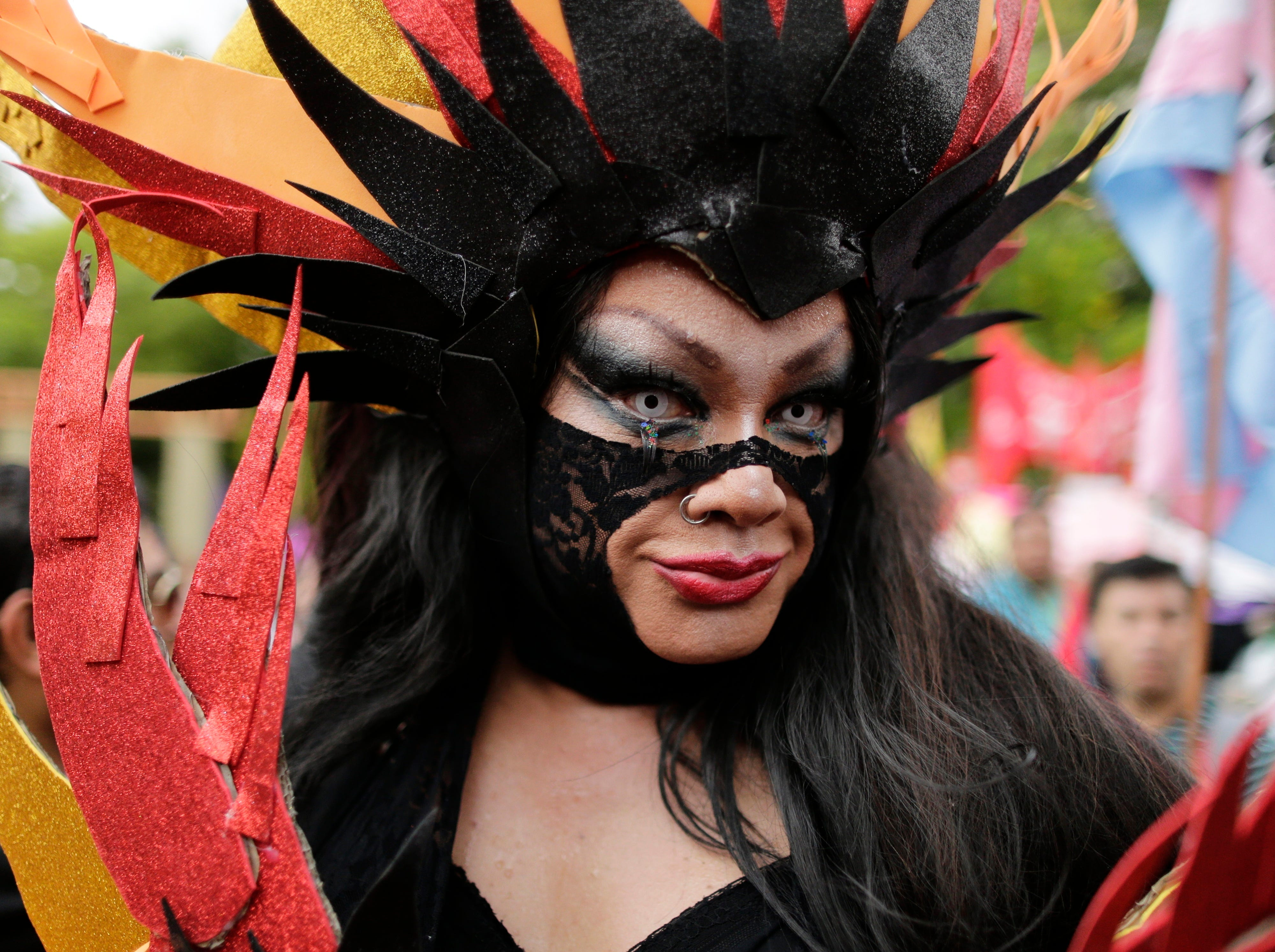 A transsexual participates in a march to commemorate International Women's Day, Friday, March 8, 2019, in Asuncion, Paraguay. Thousands of people marched in Asuncion's downtown to demand women's rights. (AP Photo/Jorge Saenz)