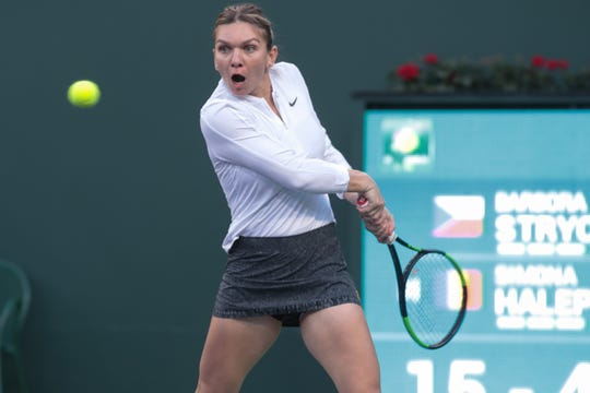 Simona Halep returns a point to Barbora Strycova during the second set of their match at the BNP Paribas Open, Indian Wells, Calif., March 8, 2019.