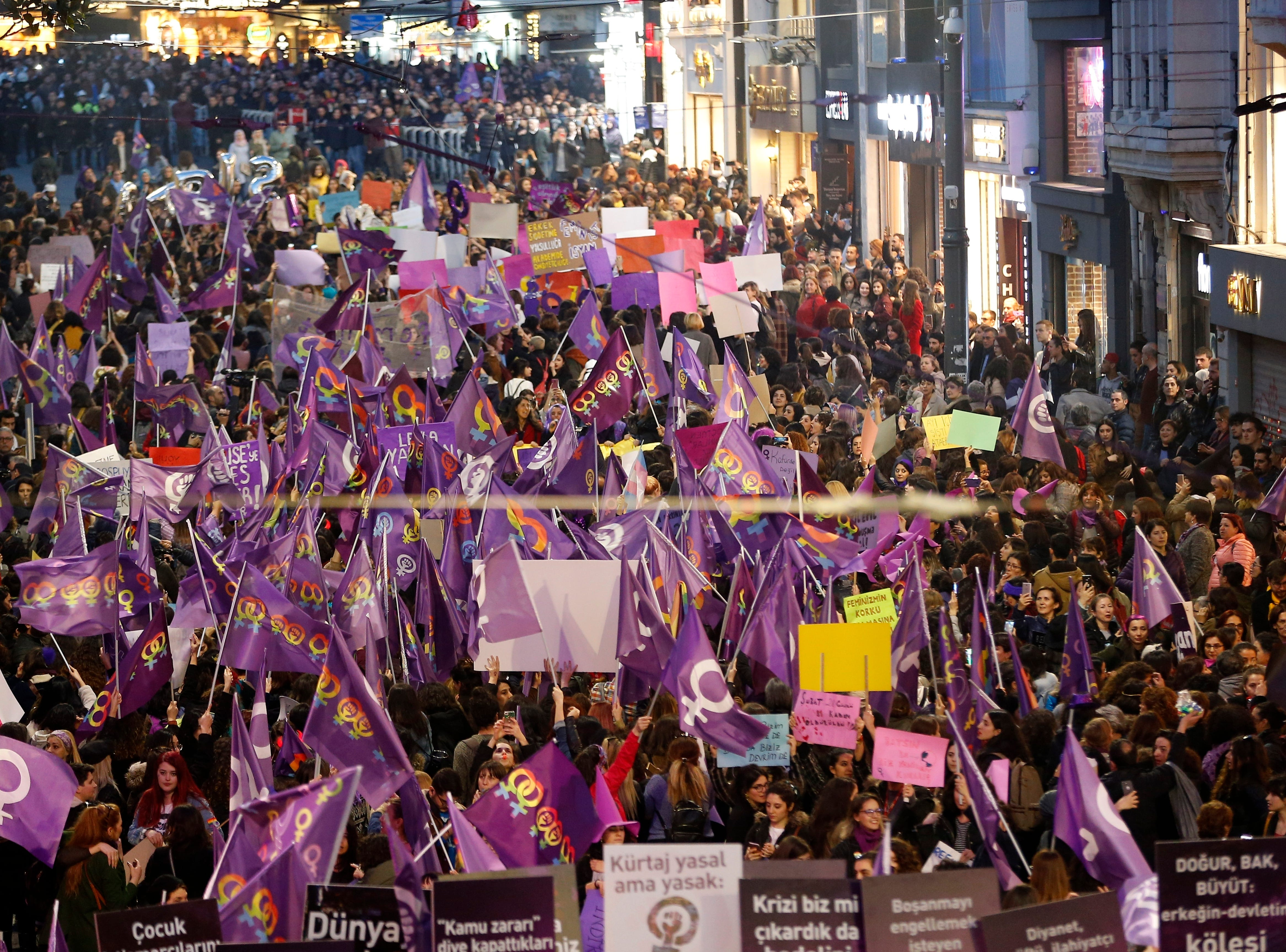 Protesters gather as Turkish police block Istiklal street, the main shopping street in Istanbul, during the International Women's Day, Friday, March 8, 2019. The day has been sponsored by the United Nations since 1975 as millions around the world are demanding equality amid a persistent salary gap, violence and widespread inequality. (AP Photo/Lefteris Pitarakis)
