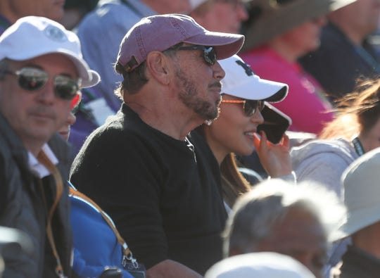 Larry Ellison watches Novak Djokovic play in a doubles match at the BNP Paribas Open, March 8, 2019.
