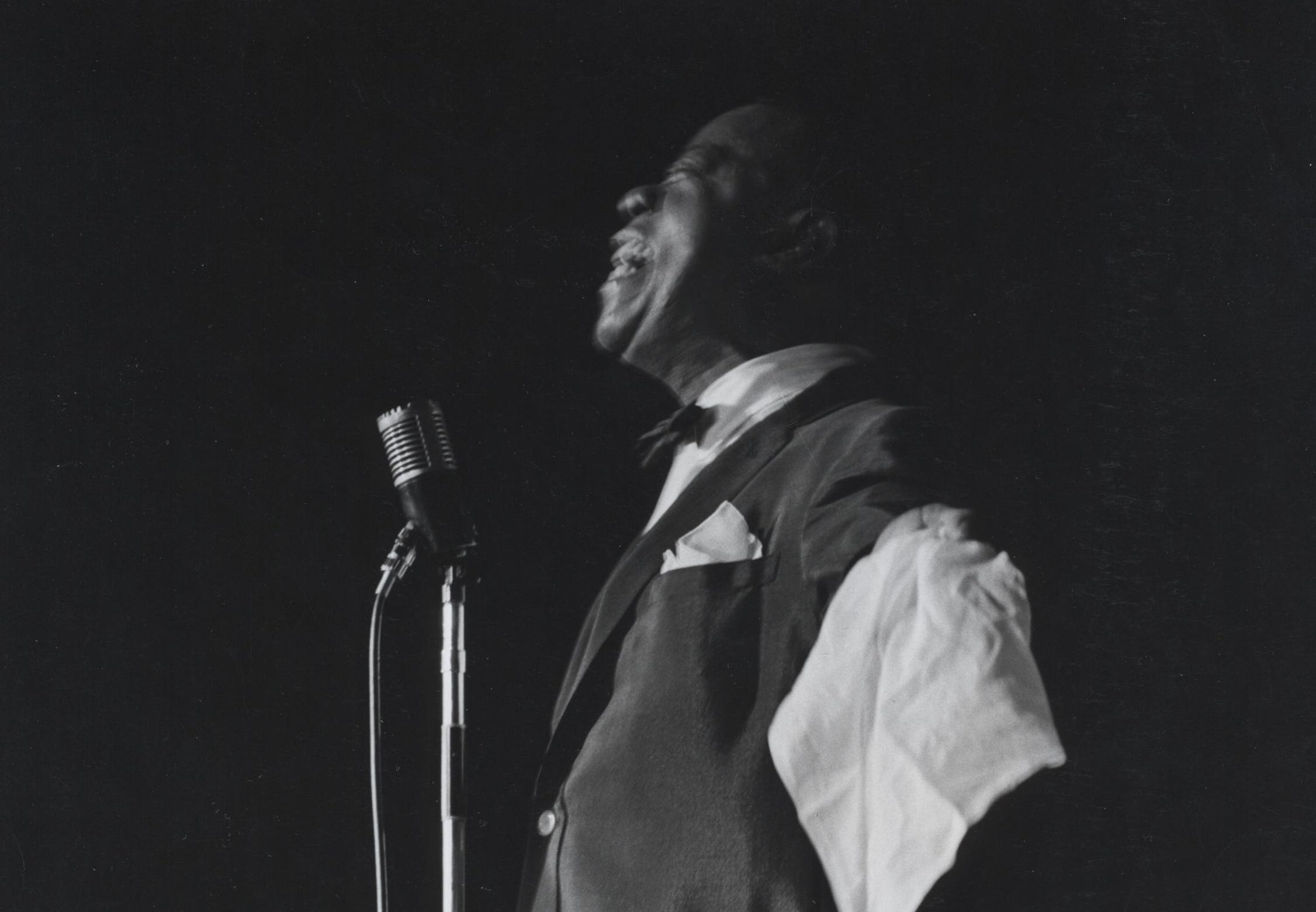 Louis Armstrong on the stage of the Chi Chi in Palm Springs.