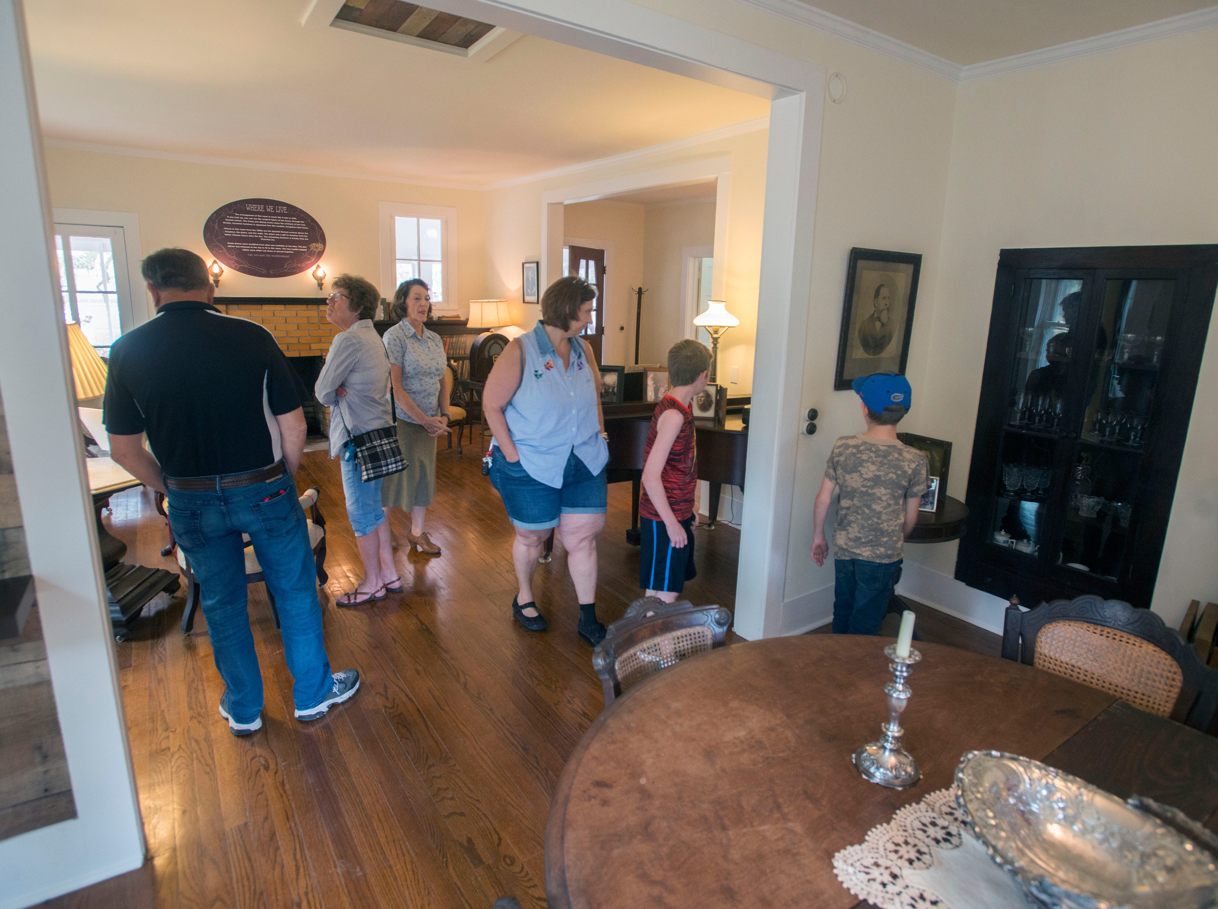 Visitors enjoy the Arcadia Homestead grand opening for the Simpson House interpretive center Saturday, March 9 2019 in Milton. The grand opening included food, displays a petting zoo and more.